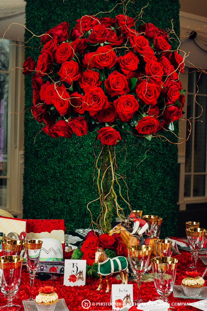 One magnificent and stunning red rose topiary anchors an exquisitely-curated Kentucky Derby tablescape!