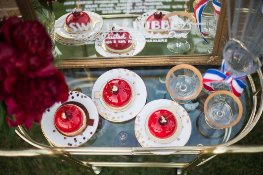 Patriotic bar cart is a must for all 4th of July Dinner Parties.