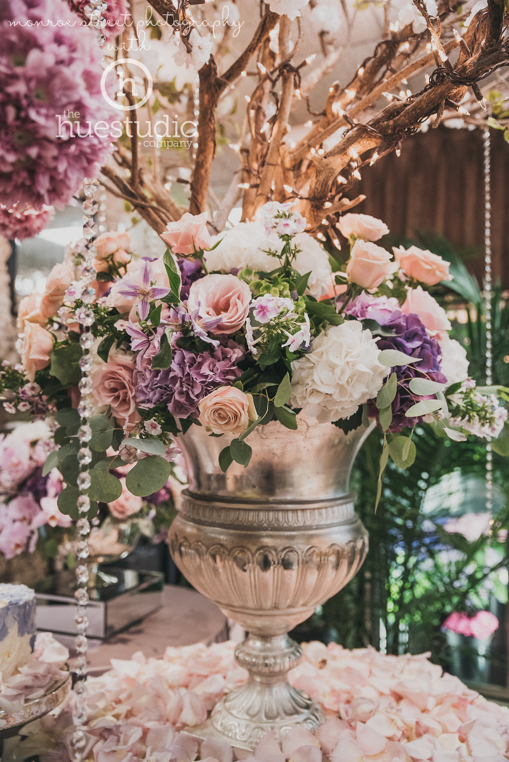 Created by the talented artisans of The Flower Studio, a magnificent silver urn anchored the elegant tablescape with luscious hydrangea, garden roses and flowing greenery.
