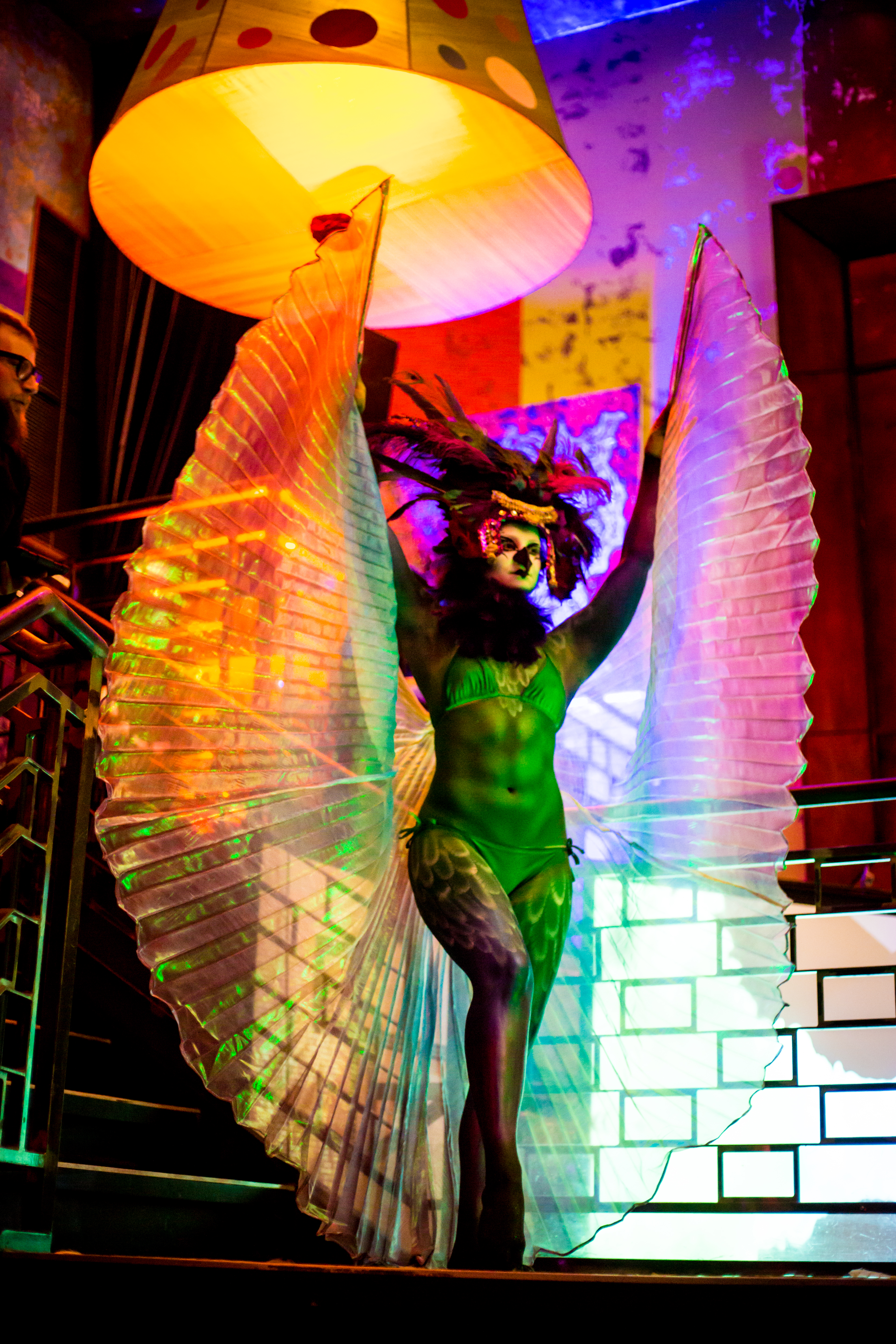 Painted Living Statue makes a dramatic entrance down the spiral stairs at Carnivale.