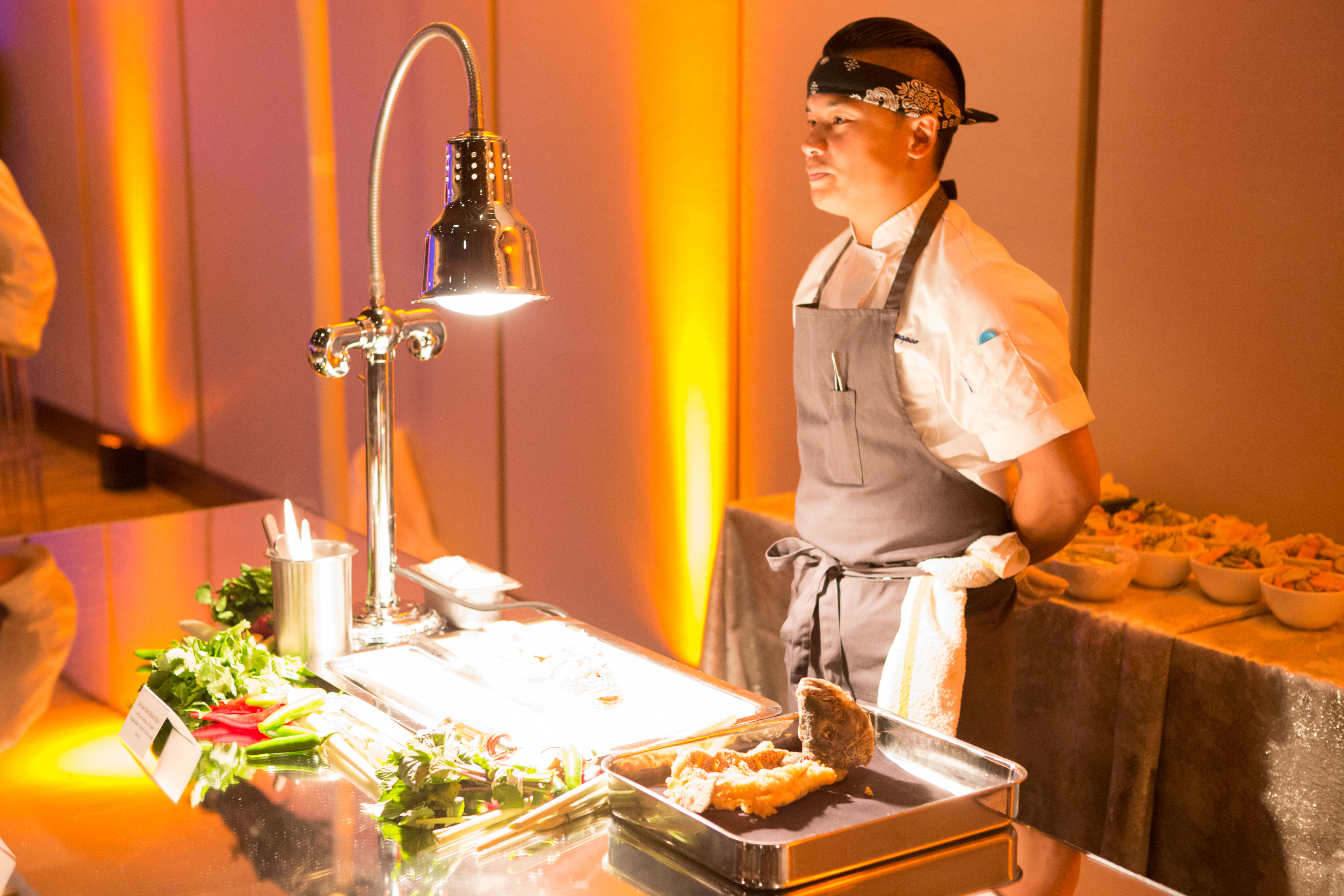 Chef Dion ready to serve Whole Black Bass served in Lettuce Cups with Garlic-Chili-Lime Sauce