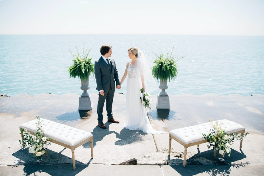 Wedding couple at their intimate lakefront ceremony altar.