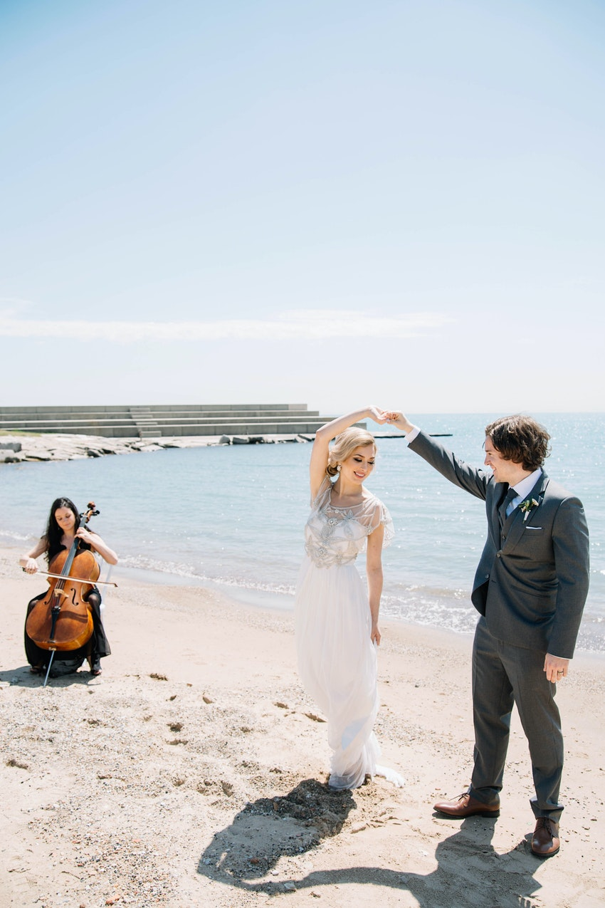 "First dance on the beach with cellist playing ""their song."""