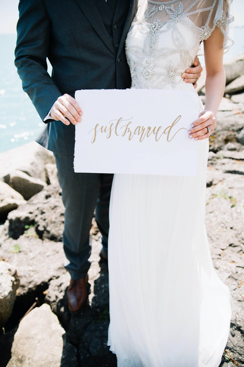 Calligraphed 'just married' sign.