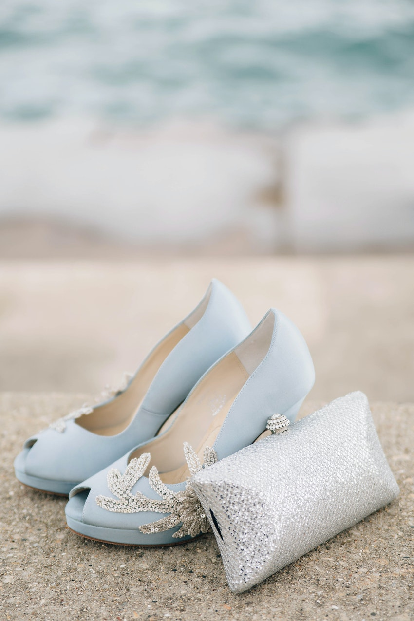 Sky blue color Anna Nuran bridal shoes made of luxe Italian silk with Swarovski crystal embellishments. Metallic box clutch.