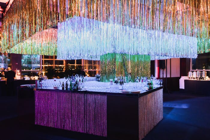 a bar surrounded by multicolored tinsel