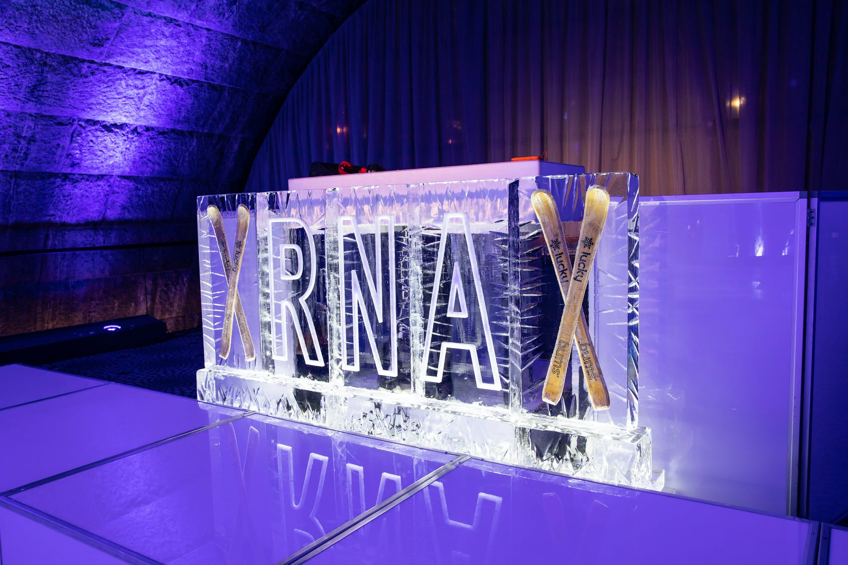 branded ice sculpture with purple dramatic lighting