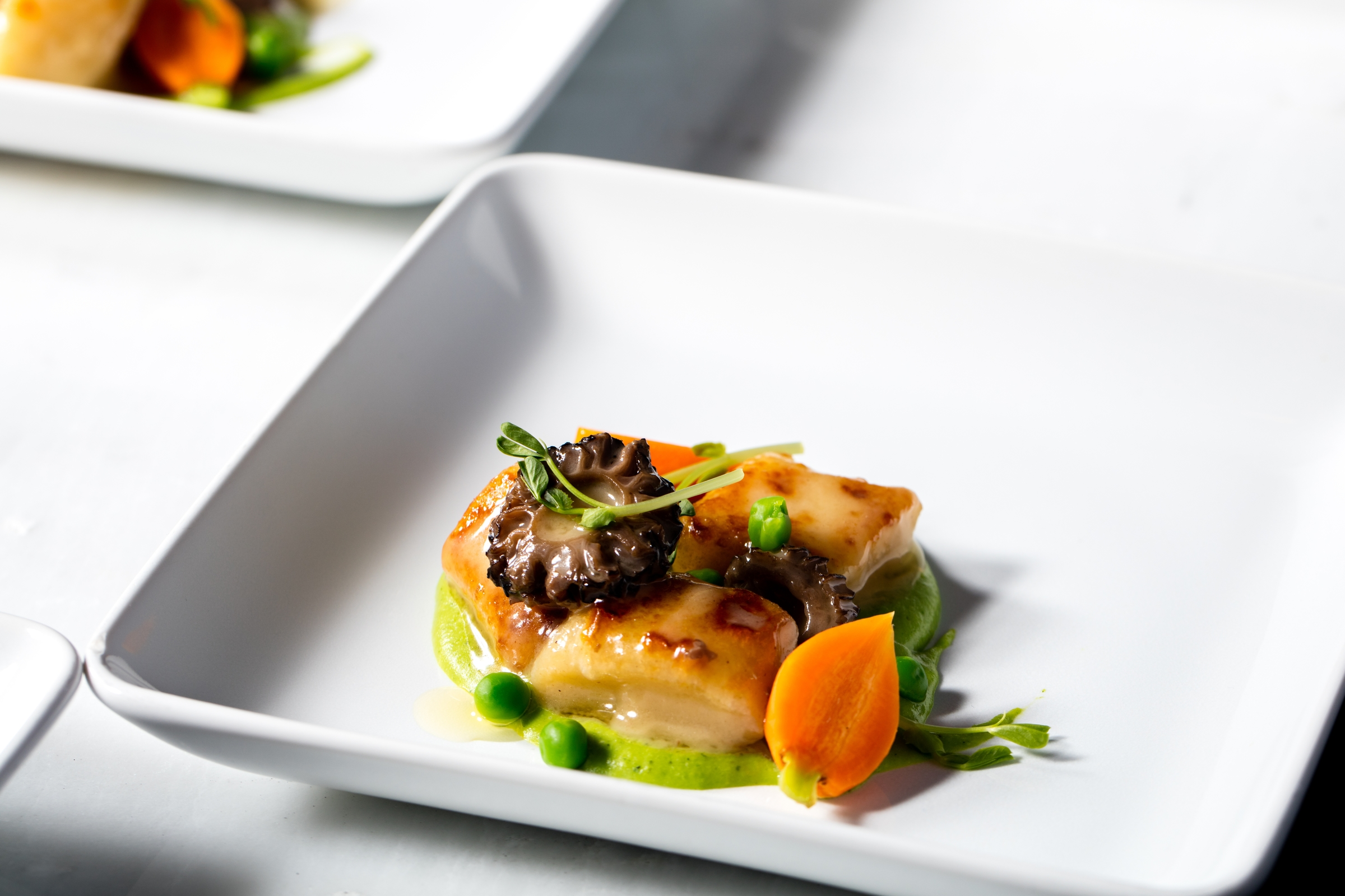 House Rolled Gnocchi with Morels, Peas and Thumbelina Carrots