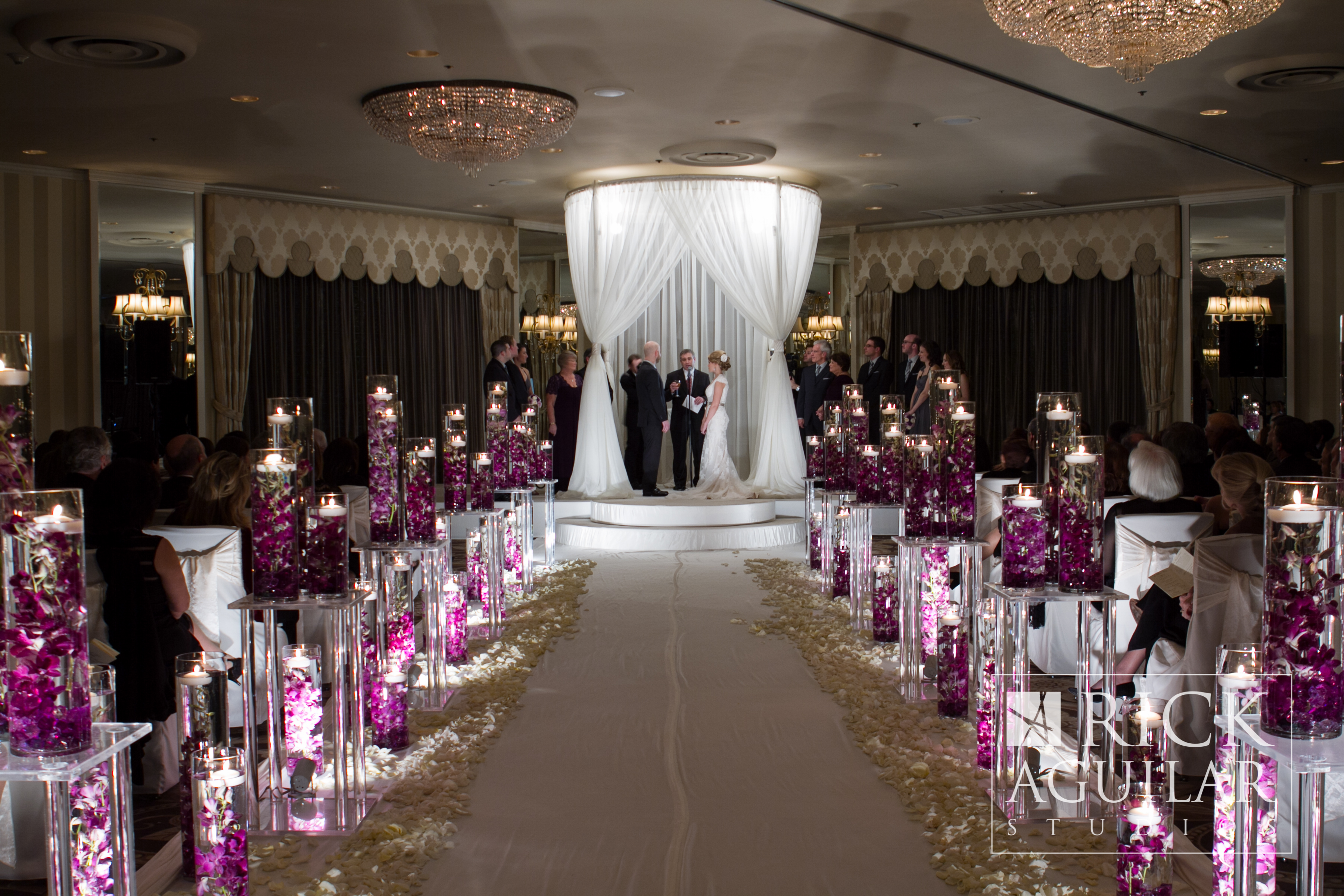 Yanni design studio wedding ceremony and aisle decor partyslate unique and modern touch to a jewish wedding ceremony with bright purple flower petals inside of reviewsmspy