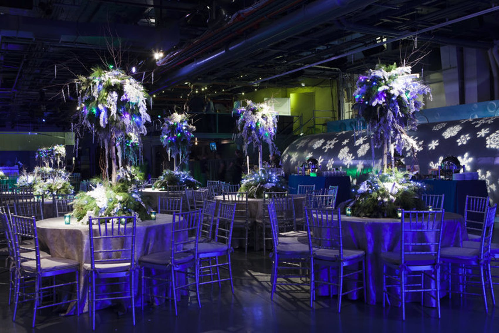 dramatic center pieces in a dim lit ballroom