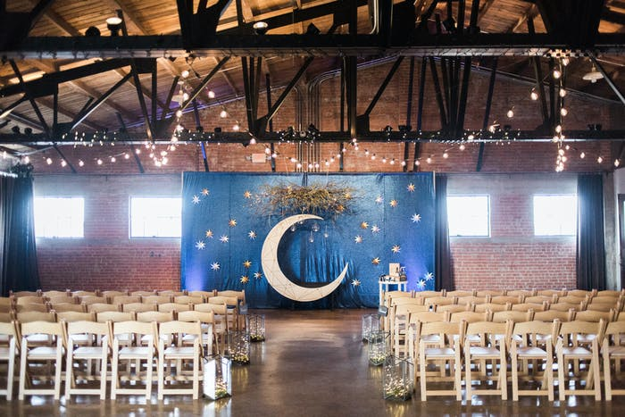 industrial chic warehouse with beamed ceiling and fairy lights.