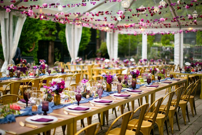 Wooden tables with pin accents and pink florals above