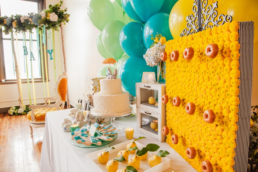 Amazing sweets table display for elephant and umbrella theme baby shower.
