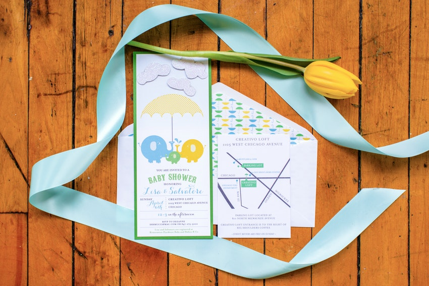 Invitations to this elephants and umbrellas themed baby shower.