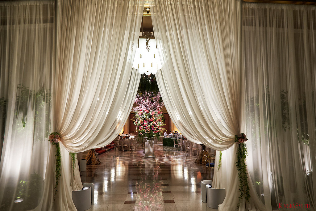 Draped fabric created the romantic entrance to this cocktail hour in the lobby of the Lyric Opera House.