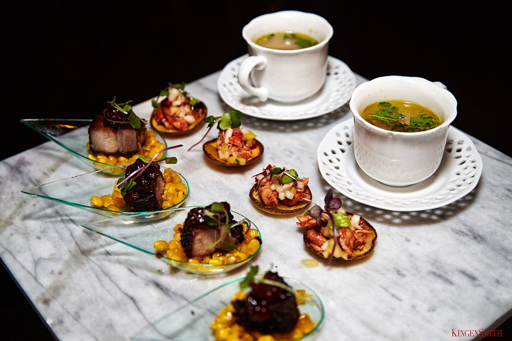 Individual Italian wedding soups, jerk chicken on a plantain and spiced chicken with charred corn