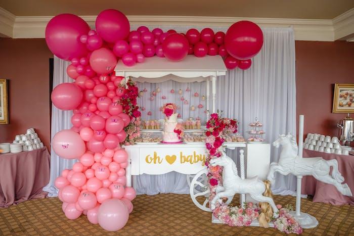 pink ombre balloon installation on baby shower dessert cart