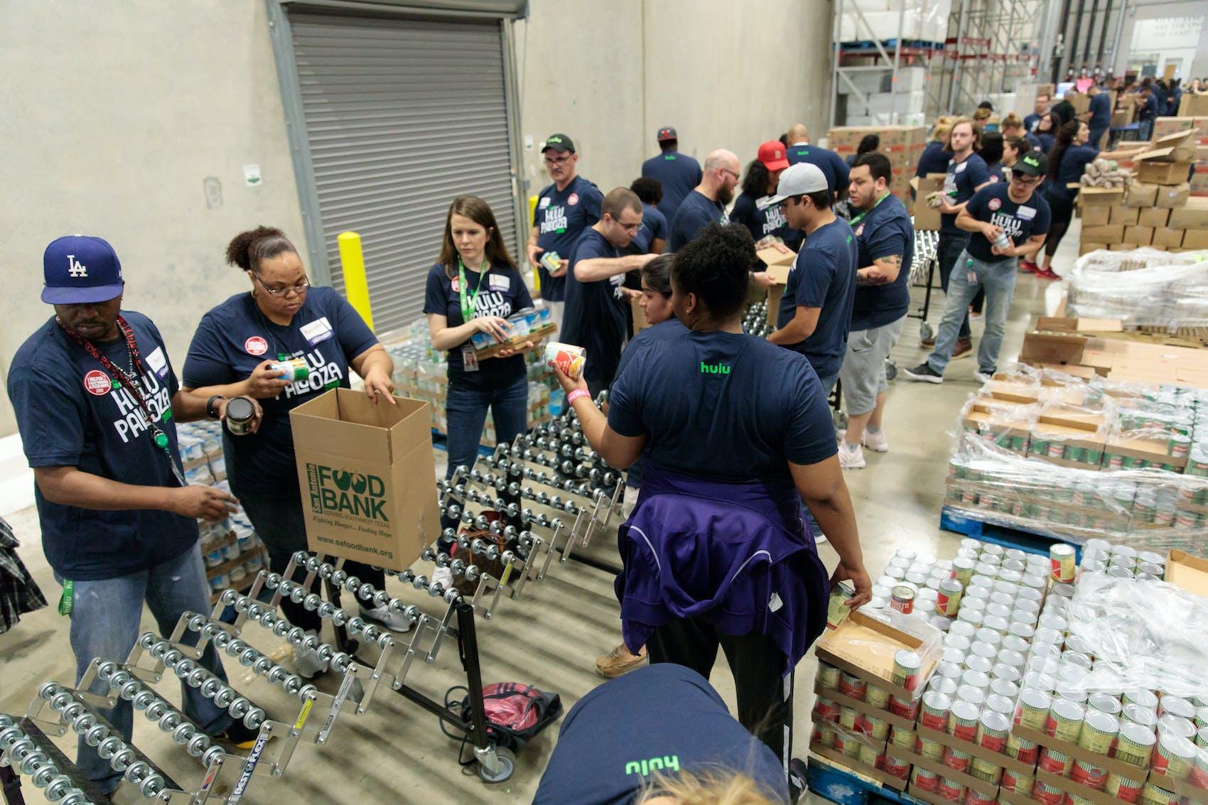 hulu employee giveback packing boxes at food bank