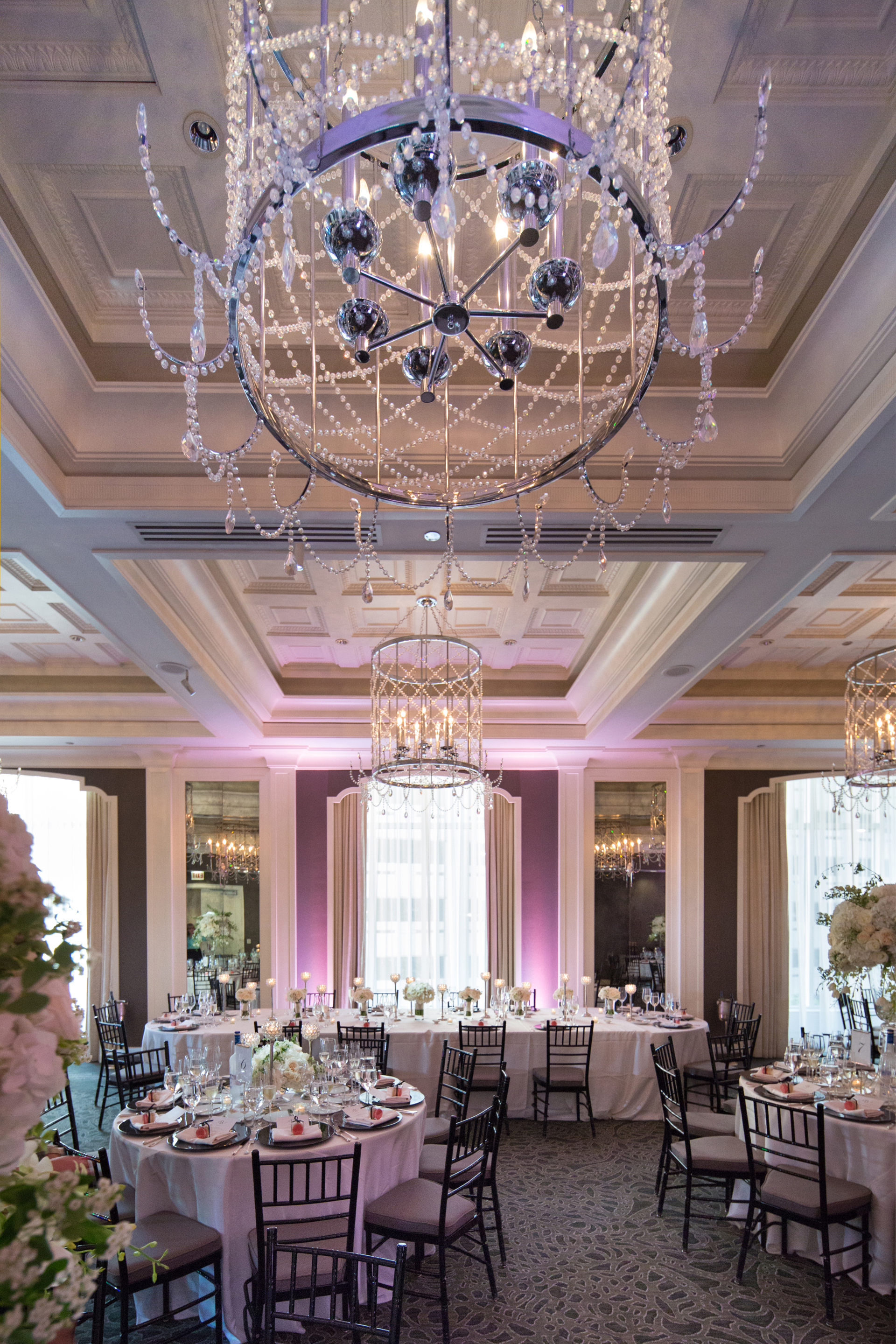 One of our favorite Chicago elegant hotel ballrooms to celebrate and photograph within. For Ray and Samantha's wedding day it was decorated to perfection with tables dressed-up in lush white flowers with silver and hanging crystal accents by Natural Beauties Floral and assistance with planning and set-up by Ashley Carpenter making the room look nothing but pure fabulous.