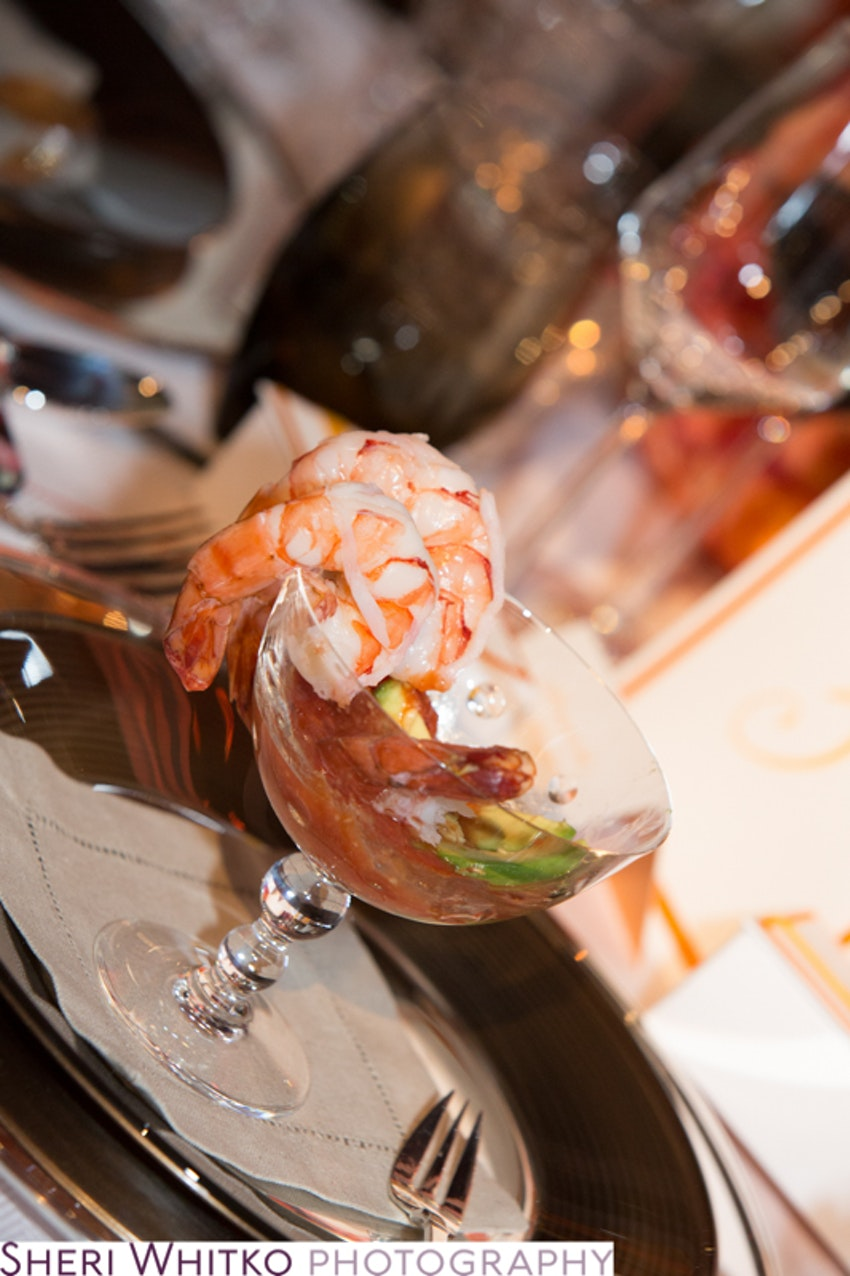 Shrimp cocktail with cocktail sauce were served as the first course during dinner.