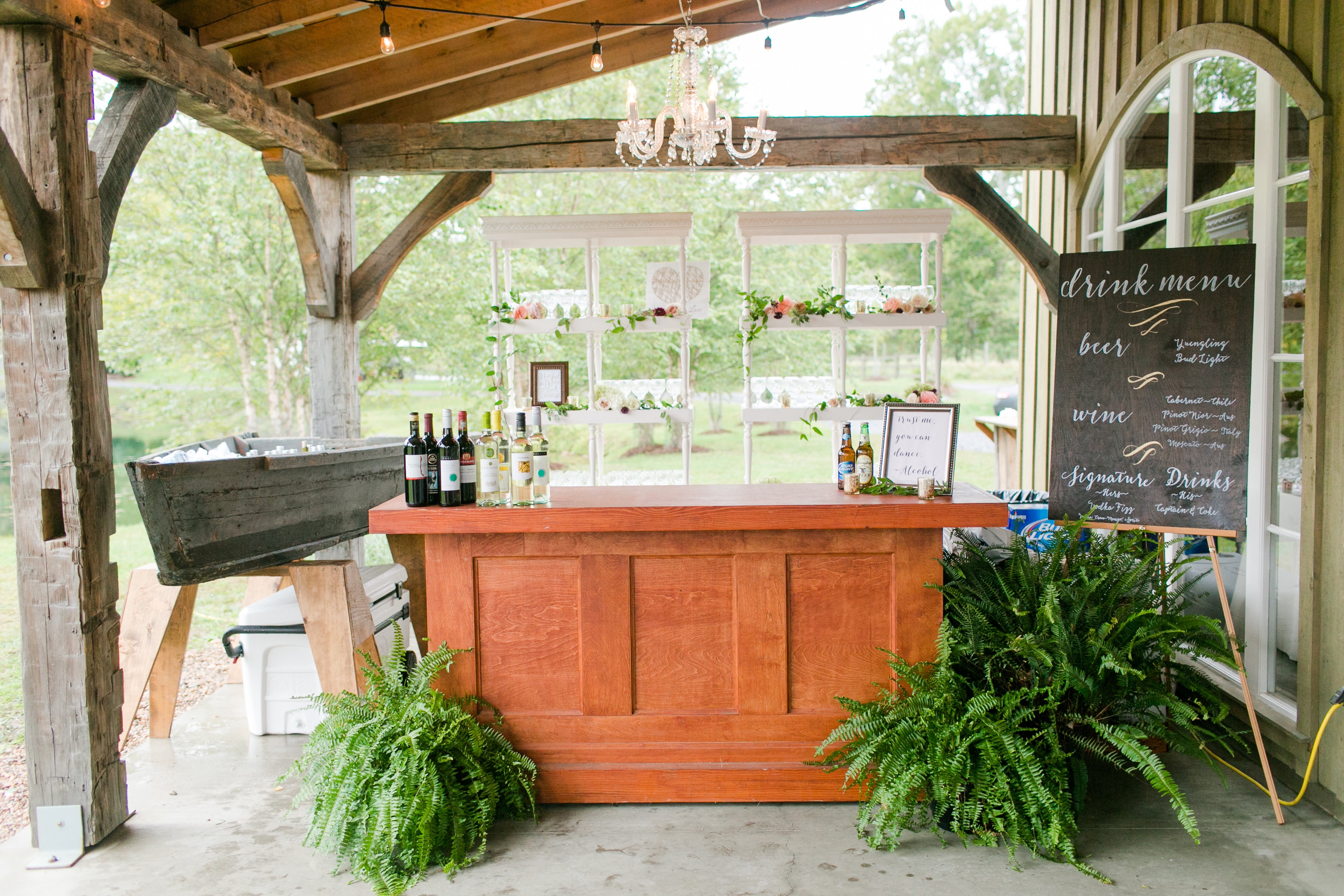 Beautiful bar area design with specialty rentals from Paisley and Jade including our Estate Bar, Edisto Bar, Cut Glass Chandelier and White Carved Post Hutches