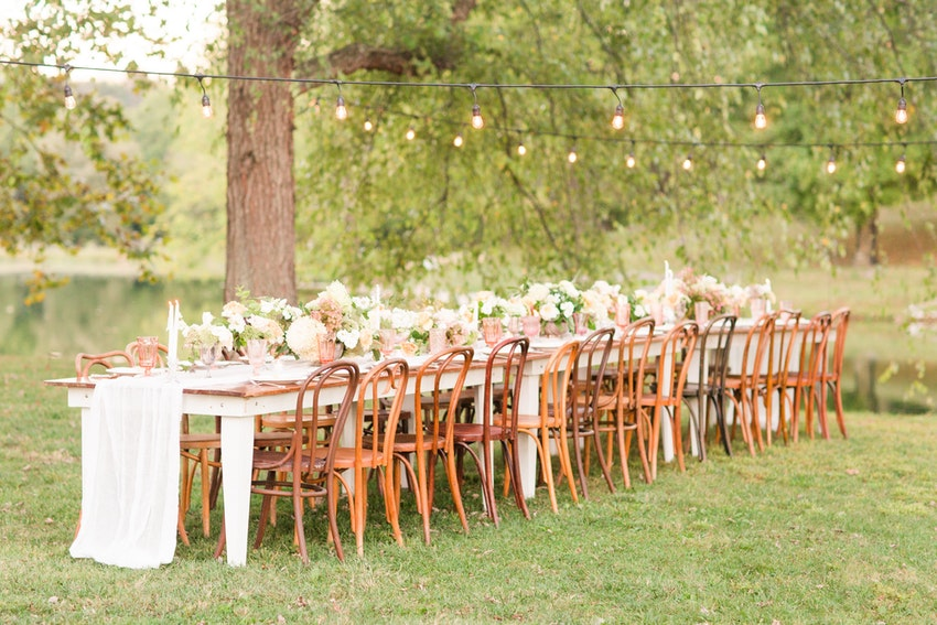 Gorgeous outdoor dining style at The Katelyn James Workshop featuring our Heritage Farm Table and Bentwood Chairs.