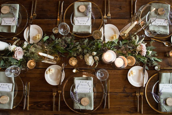 Overhead shot of a table set up with votive candles and greenery