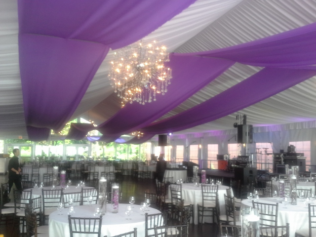 Fabric Swags and uplights compliment the color scheme at this corporate event