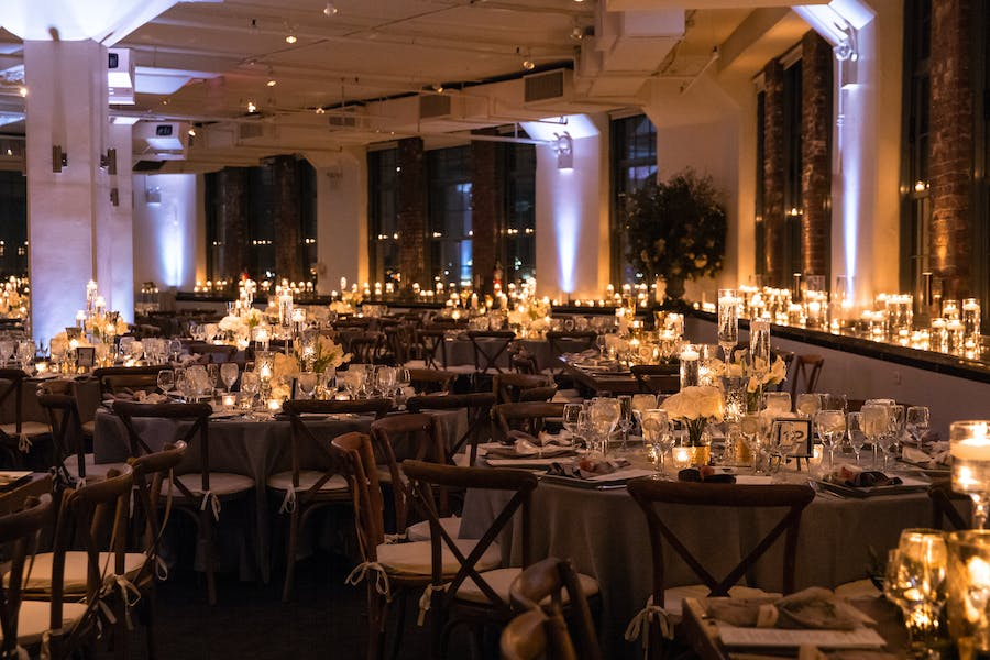 Room filled with tables and candles.