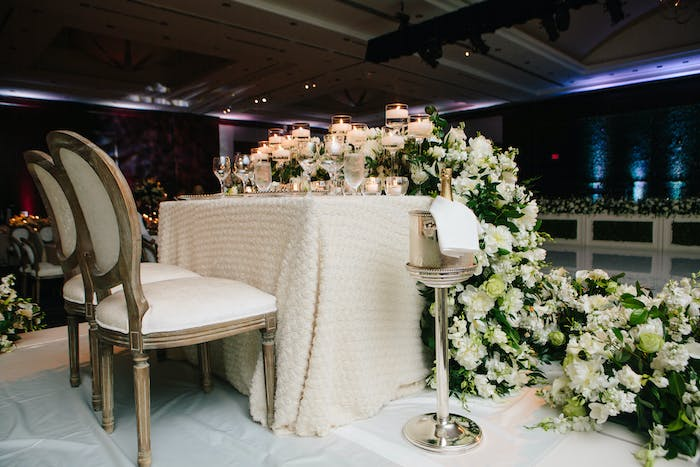 The bride and groom table with cascading white florals