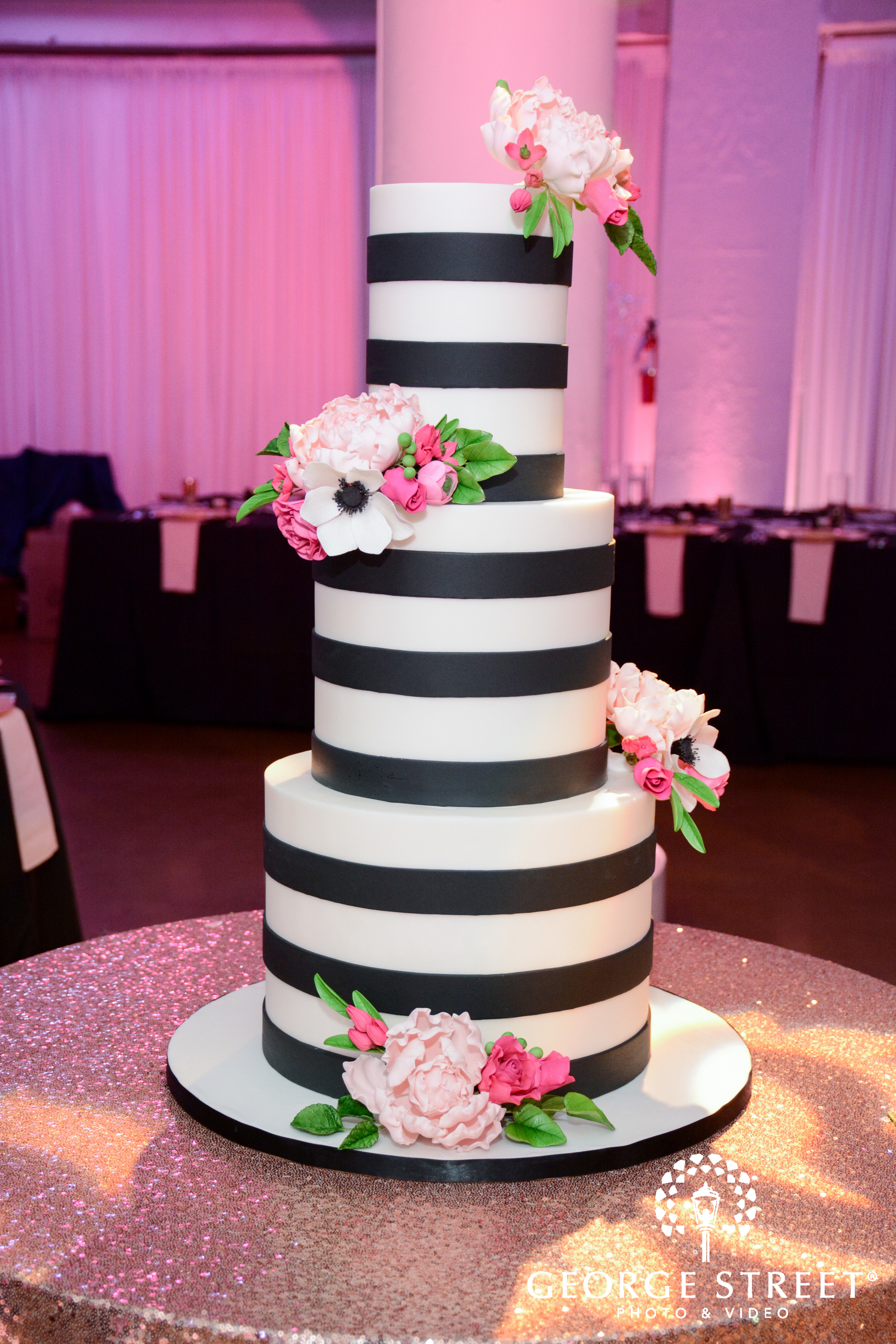 Elysia root cakes wedding cakes partyslate hot pink and blush pink flowers pop against a background of modern black and white fondant mightylinksfo Image collections