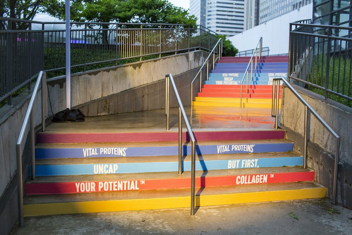 Concrete outdoor stairs are painted different colors.