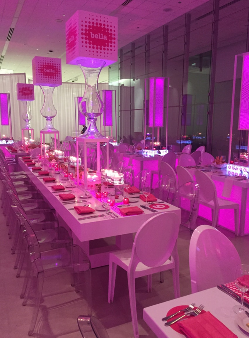 Tags bar and bat mitzvah event decor themes venues - Pink Lighting Everywhere Reflecting Off Of The Ghost Chairs And Modern White Venue