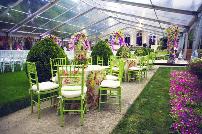A clear tent with green furniture and ink accents.