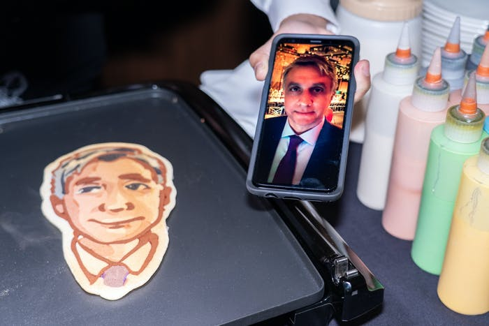 a selfie of a man next to a pancake art drawing of the selfie.