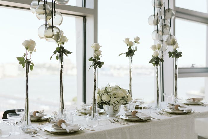 An all white color palette looks out the bright windows.