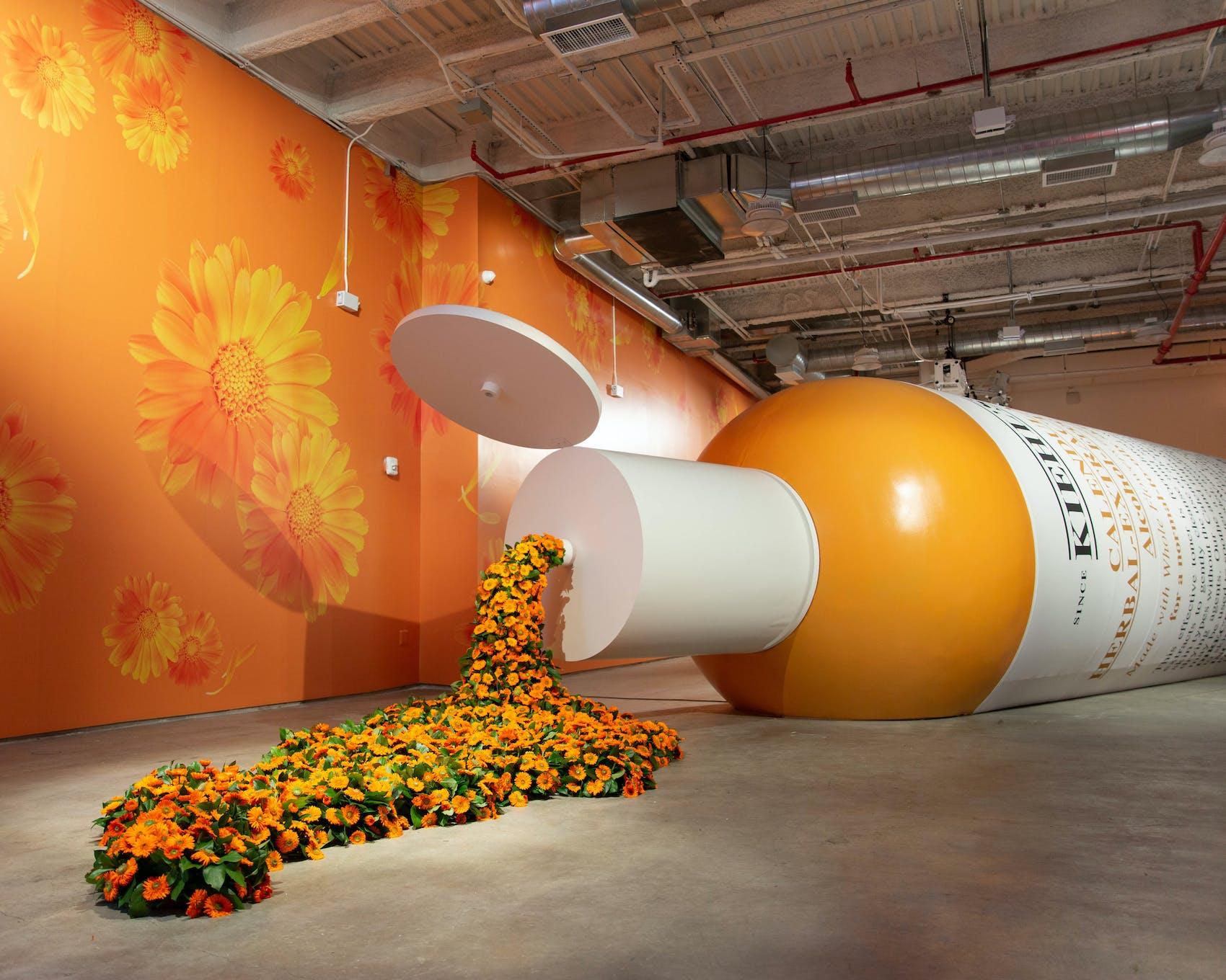 oversized keihl's bottle party installation