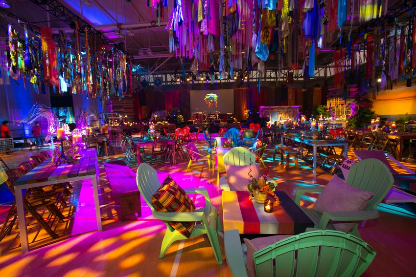 The use of dramatic colorful lighting made this gym truly look like a Jamaican town.