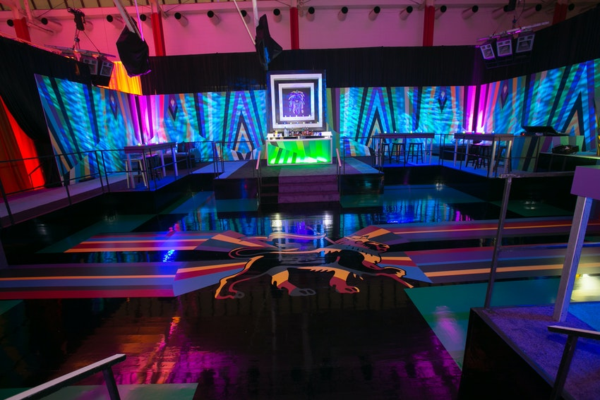 A custom night club was created featuring a sunken dance floor, lion logo and elevated seating provided a great space for kids to dance and parents to watch!