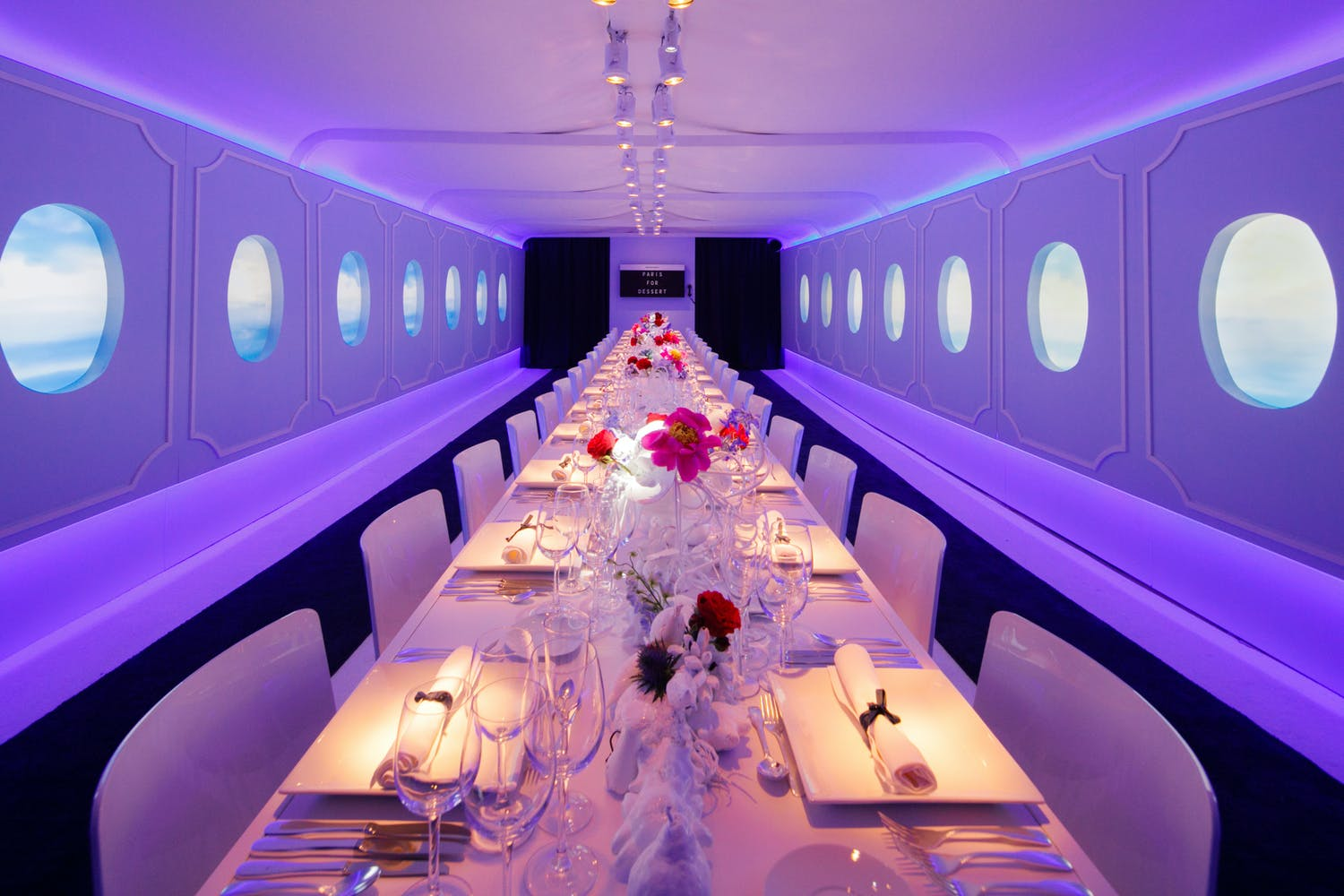 dinner party that looks like its aboard a luxury jet