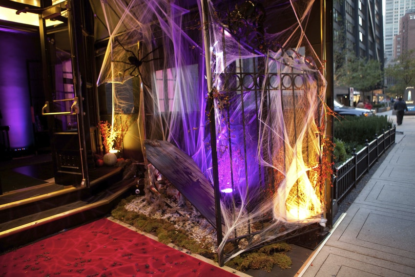 Guests arrived at a cobweb-drenched Casino Club, entering via red carpet replete with cockroaches and spiders spilling forth from an open, occupied casket.