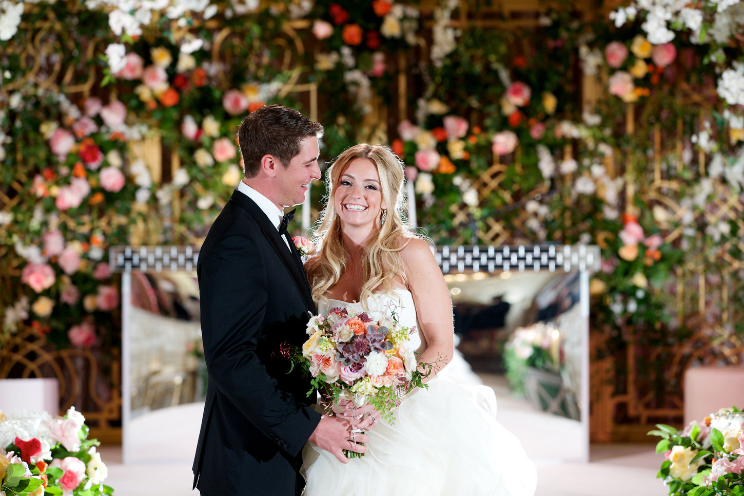 ASHLEY AND MICHAEL'S WEDDING WAS INCREDIBLY LUSH WITH FLOWERS BUT THE LOVE IN THE ROOM WENT FAR BEYOND LUSH, IT WAS UNDENIABLE! A TRULY WONDERFUL FAMILY! THIS BEAUTIFUL WEDDING WAS FEATURED IN INSIDE WEDDINGS AND WAS PERFECT IN EVERY WAY!