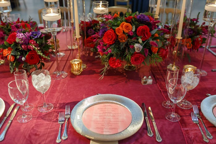 Red tablescape with red linens and red roses.