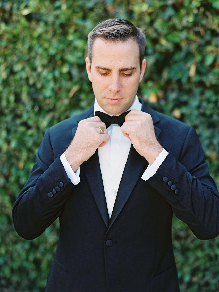 Groom in his Giorgio Armani Black Label tuxedo