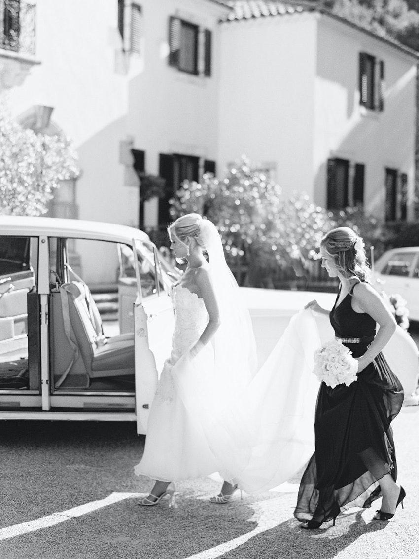 Bride getting into Rolls Royce going to ceremony