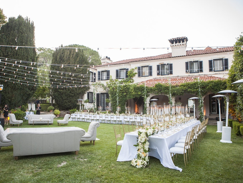 Long dining tables and floral garland