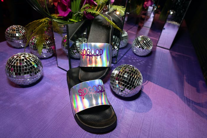 purple floor with close-up of iridescent saddle and glittering-mini disco balls