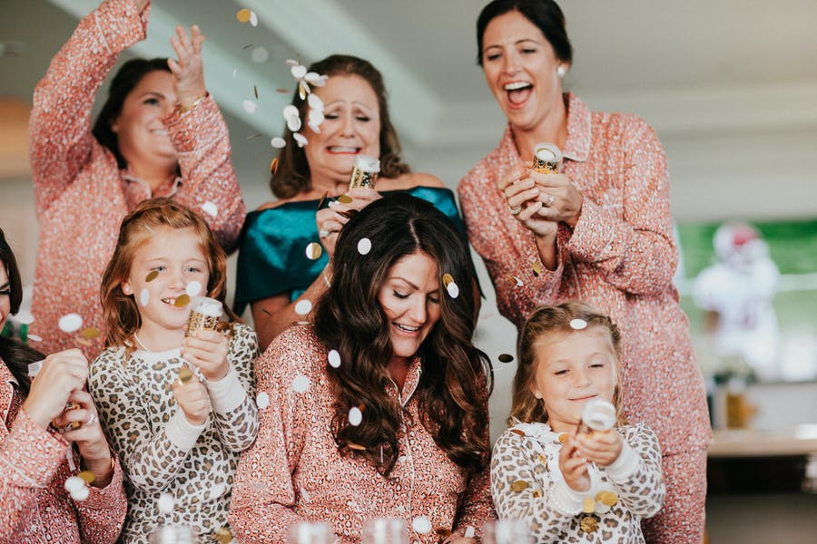 Women in pajamas have confetti cannons.