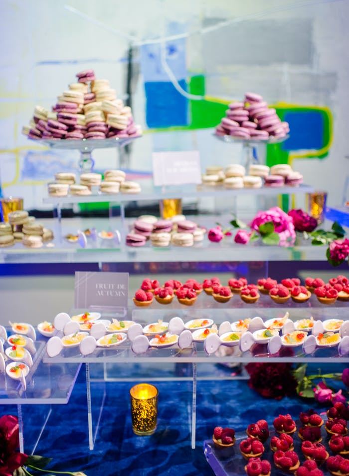 A dessert table with colorful entries