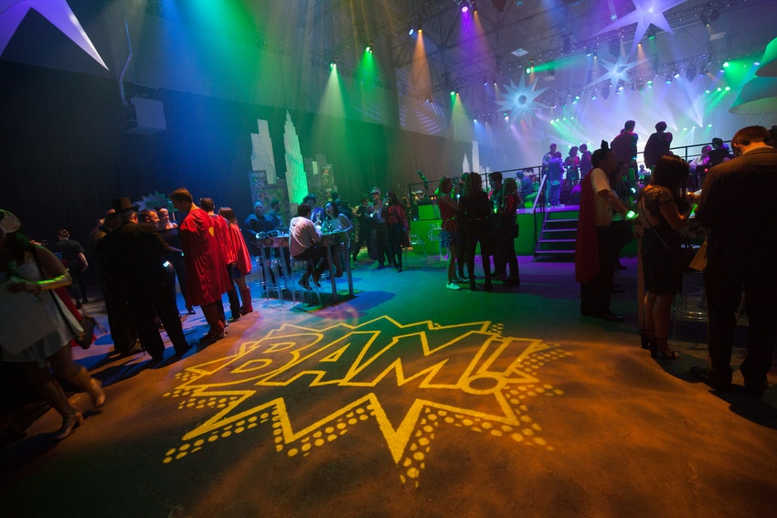 "Lighting from John Featherstone made the entire venue pop with unique superhero logos such as this ""BAM!"" brightly lit on the floor."